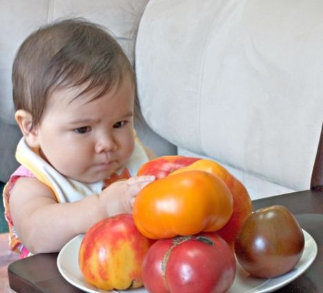 Baby thinking about nutritious foods