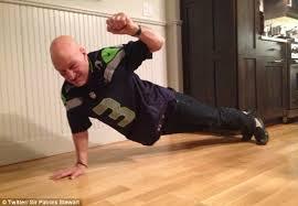 actor Patrick Steward doing 1 arm pushup