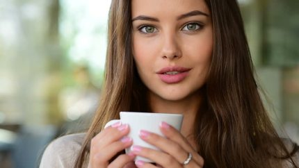 woman enjoying drinking coffee